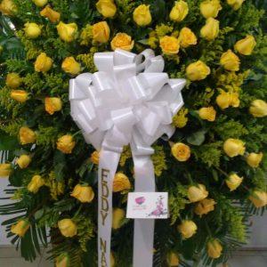 Corona fúnebre rosas amarillas y solidago